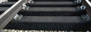 Railroad ties made from recycled tires